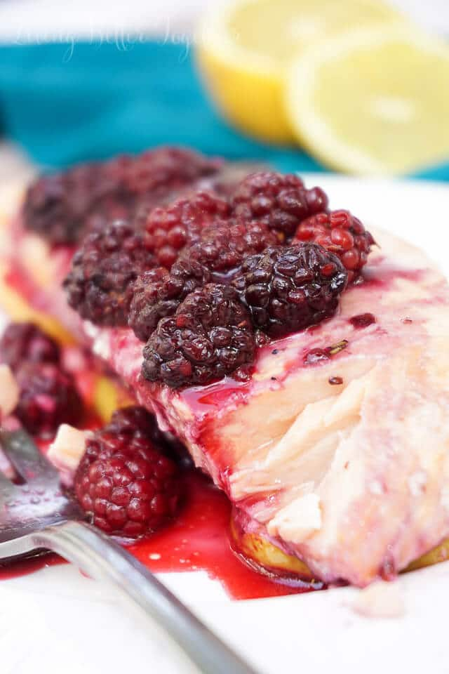This gorgeous Blackberry Lemon Salmon is a light and flaky dinner recipe that's baked to perfection in just 30 minutes!