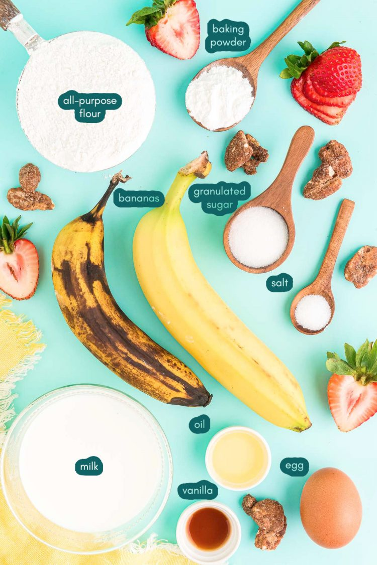 Overhead photo of banana pancake ingredients prepped on a teal surface.