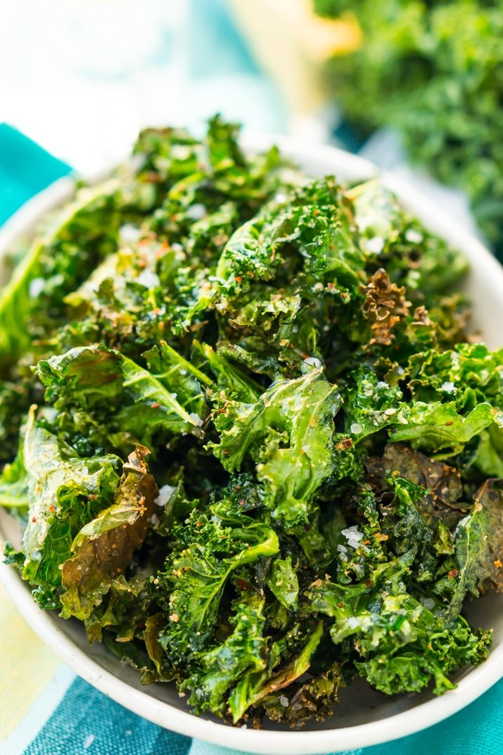 Kale Chips are easy, healthy, and addictive! You'll love this simple, crunchy snack that's loaded with delicious flavor and nutrients! Only 50 calories and 1 Weight Watchers Smart Point per serving!