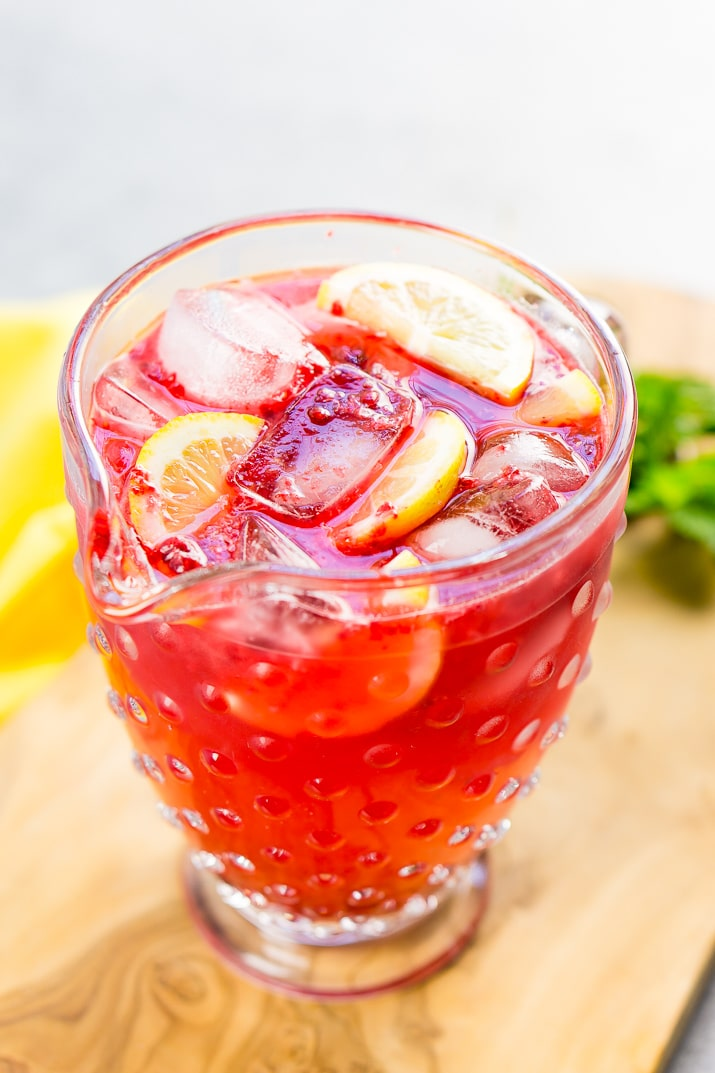 This Sparkling Raspberry Lemonade is a delicious and refreshing fruity drink that's made with raspberries, lemons, simple syrup, and club soda.