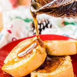 This Eggnog French Toast is dipped in a mixture of eggnog, eggs, rum, vanilla, and nutmeg before it's cooked to perfection and slathered in syrup for a delicious holiday breakfast!
