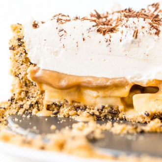 Banoffee Pie is a classic English dessert made with a graham cracker or biscuit crust and loaded with slices of banana, a silky layer of toffee caramel, and a thick layer of freshly whipped cream.