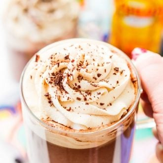 This Kahlua Hot Chocolate is so rich, creamy, and BOOZY! This hot chocolate recipe is laced with coffee liqueur and topped with a Kahlua Whipped Cream and chocolate shavings.