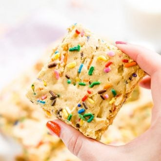 These Birthday Cake Blondies are made with anadapted yellow cake box mix and are so easy to make! They're sweet and fun and loaded with sprinkles!