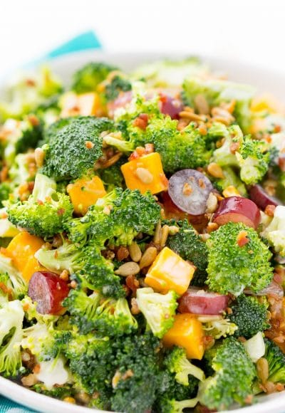 This Sweet Broccoli Salad is an easy, crunchy, and lightly sweetened side salad that's perfect for BBQs and more! Made with fresh broccoli, grapes, cheese, sunflower seeds, bacon, and a delightful dressing! Bring it to all your summer get-togethers!