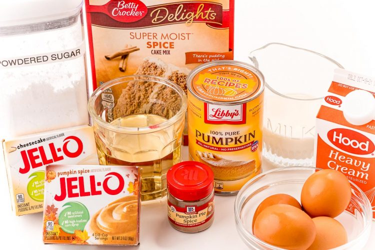 Ingredients to make pumpkin cupcakes on a white table.