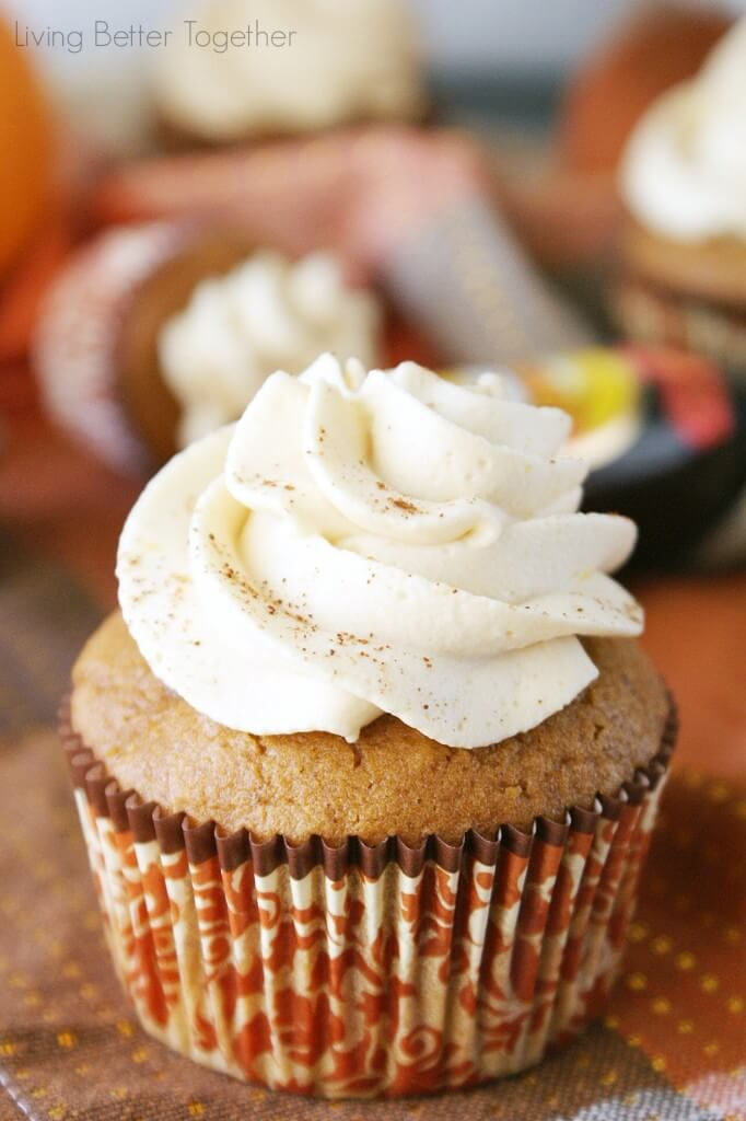 Pumpkin Cupcake with a white frosting dusted in pumpkin spice.
