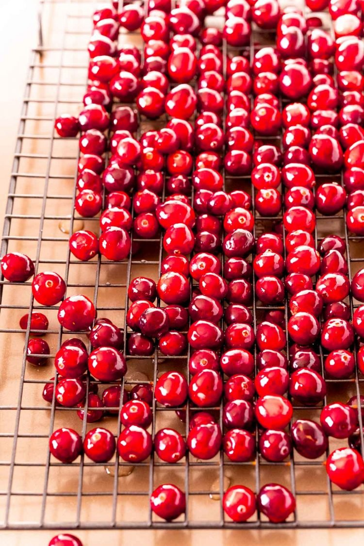 Cranberries on a wire rack.