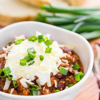 This HEALTHY and EASY Turkey Chili Recipe has perfect heat and a SECRET INGREDIENT that makes it the ultimate winter meal and great for game days!
