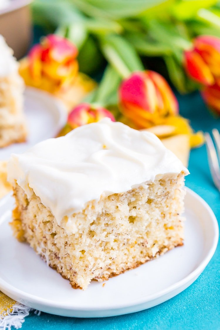 This is the Best Banana Cake recipe EVER! It's moist and sweet andtopped with a tangy cream cheese frosting!