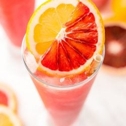 This Blood Orange Cocktail made with blood oranges, gin, lemon juice, citrusbitters, Cointreau, and ice. It's a sexy, fun, and tasty pink drink I call a Citrus Tango!
