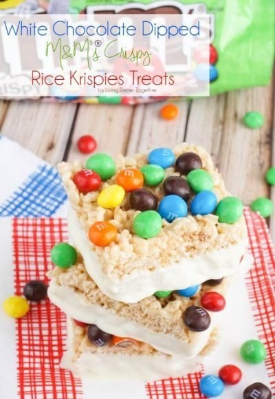 These White Chocolate Dipped M&M's® Crispy Rice Krispies Treats are a 90s kid's dream. The classic rice krispies treats are topped with M&M's® Crispy candy and dipped in white chocolate for a perfect finish! #CrispyIsBack #Ad