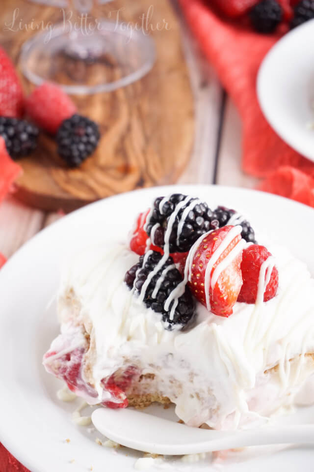 This Berry Wine Icebox Cake is a simple no fuss dessert perfect for summer. It's made with wine macerated berries, graham crackers, white chocolate pudding and homemade whipped cream!