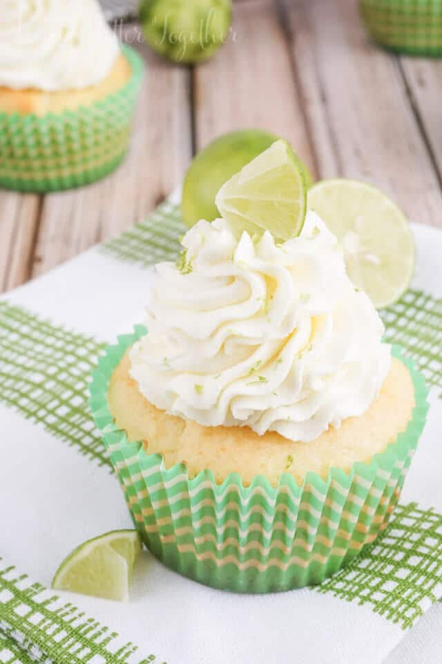 These Key Lime Pie Cupcakes are light and fluffy, filled with sweet key lime curd and topped with a whipped vanilla lime frosting!