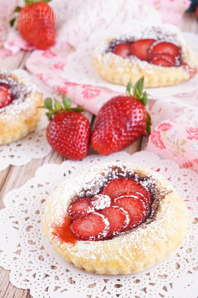 These Strawberry Nutella Tarts inspired by The Selection Series are so simple to make. Rich and creamy Nutella and tart strawberries in a flaky pastry dusted in sugar - they're absolutely divine!