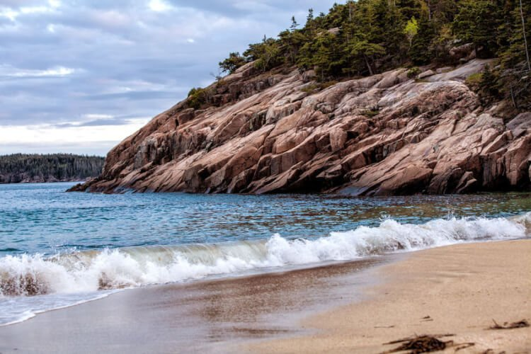 What to eat and do and where to stay in Maine's gorgeous Acadia National Park. Explore this rugged coastal National Park with attractions like Sand Beach, Bass Harbor Head Lighthouse, and Cadillac Mountain.