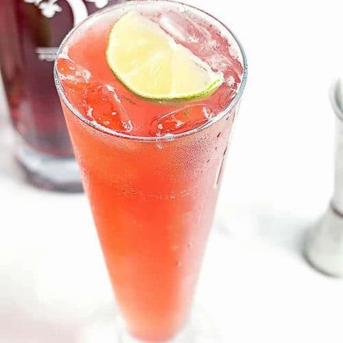 This Irish Doe Cocktail is made with bold Irish whiskey, smooth pomegranate liqueur, ginger ale and lime juice. It's perfect for all your summer celebrations!