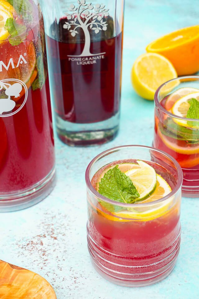 Celebrate summer with this Pomegranate Citrus Rum Punch! Sweet PAMA Pomegranate Liqueur paired with lemonade, lemon lime soda, and rum for a splash of summer fun