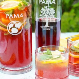 Celebrate summer with this Pomegranate Citrus Rum Punch! Sweet PAMA Pomegranate Liqueur paired with lemonade, lemon lime soda, and rum for a splash of summer fun.