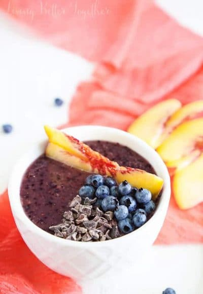 This simple and light Blueberry Peach Smoothie Bowl is both gluten and dairy free. Blend it up in minutes for a breakfast that's loaded with antioxidants, calcium, and flavor!
