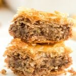 Two pieces of Baklava stacked on top of each other.