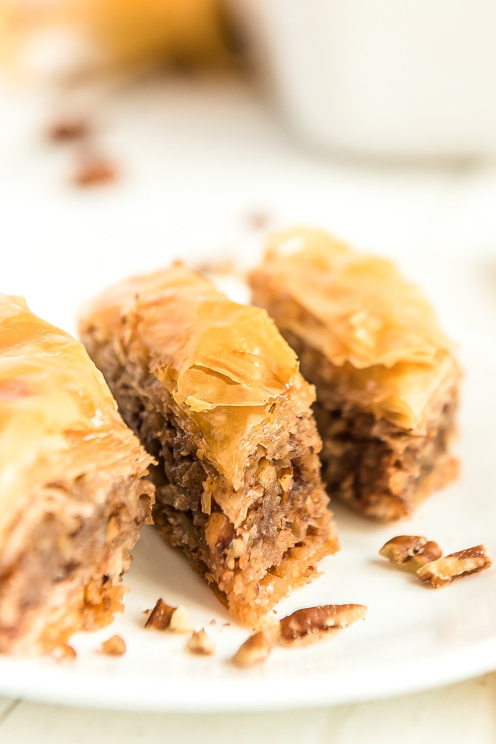 Three pieces of baklava on a white plate.