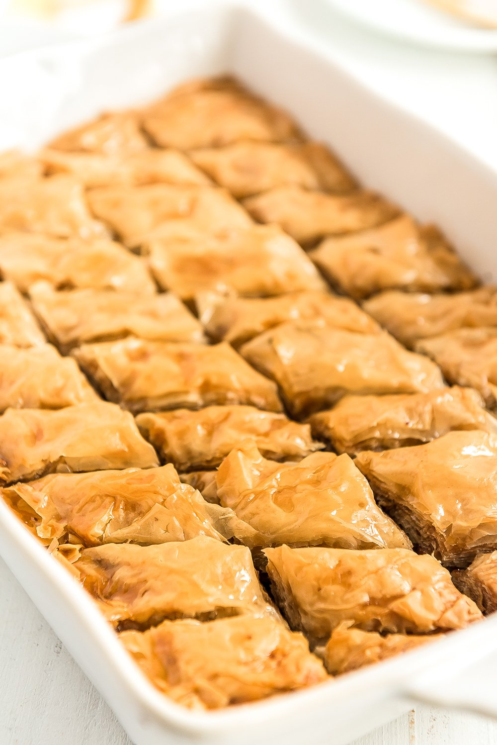 Baked baklava in a white baking dish.