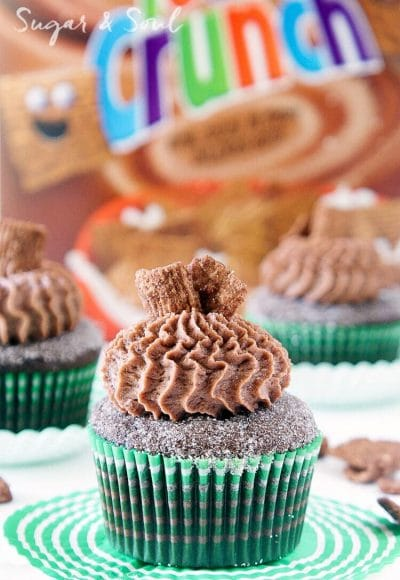 These Chocolate Cinnamon Toast Crunch Cupcakes are everything you loved about childhood rolled up into one! Moist chocolate cake loaded up with cinnamon and topped with a whipped chocolate frosting laced with cereal pieces!