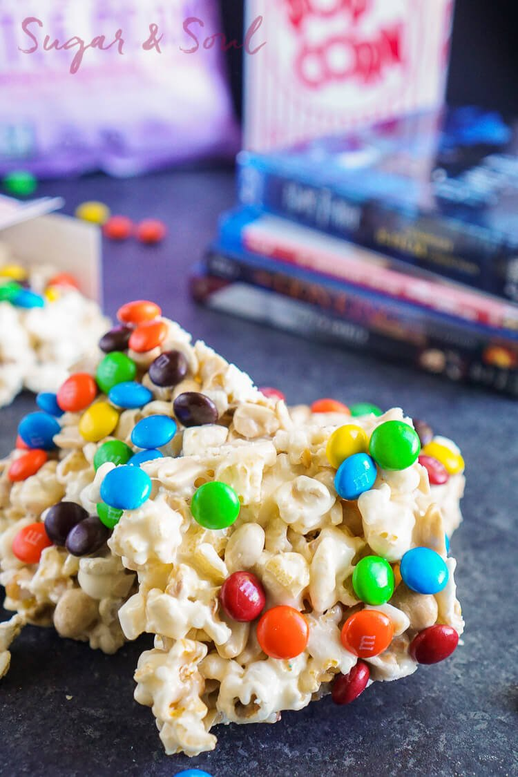 These Movie Night Marshmallow Treats are so easy to whip up! A buttery marshmallow treat loaded up with popcorn, peanuts, and chocolate - Perfect for movie night!