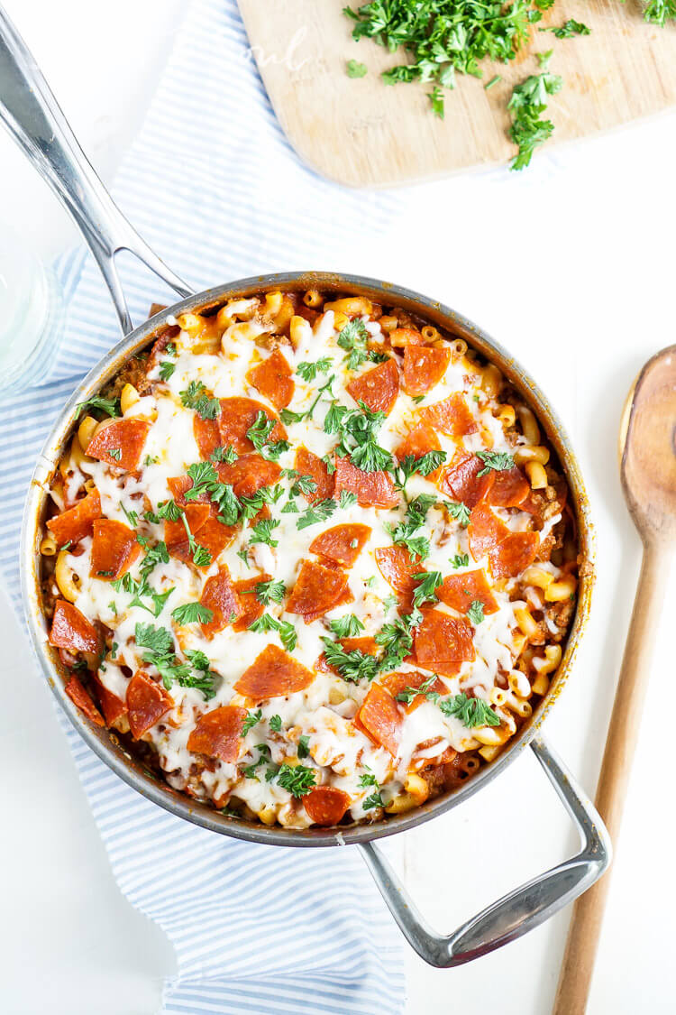 This One Pan Pizza Pasta is what weeknight dreams are made of! Pizza and pasta come together in an easy meal loaded with flavor that's ready in less than 30 minutes!