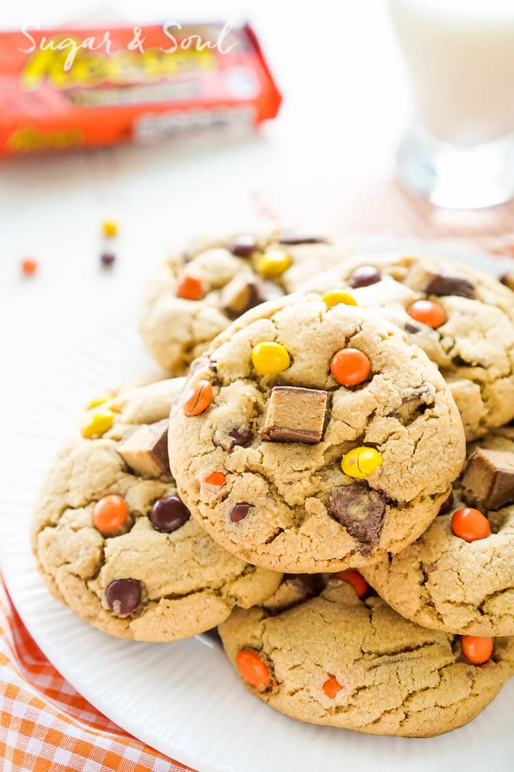 These Overloaded Reese's Peanut Butter Pudding Cookies are a sweet peanut butter cookie full of Reese's Pieces and Chunks of Reese's Peanut Butter Cups.