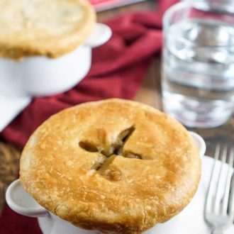 This Tourtière is a traditional Spiced Meat Pie made in Quebec, beef and veggies with cinnamon and clove give this dish a unique cozy flavor perfect for cold weather.