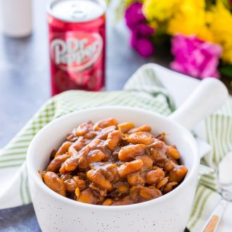 These Dr Pepper Baked Beans are a sweet and delicious side dish that's ready in less than an hour! Perfect for BBQ's and game day parties!