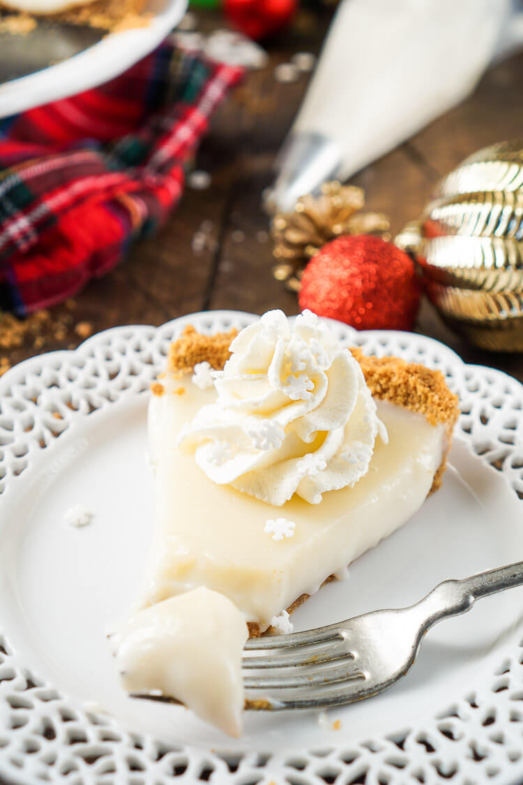 This literally tastes like Christmas, or at least those were the words out of my mother's mouth when she took her first bite! This Sugar Cookie Cream Tart has a sweet smooth filling wrapped in a graham cracker crust that's perfect for the holidays.