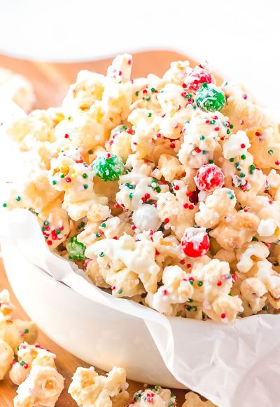 Close up photo of Christmas Popcorn in a small white bowl.