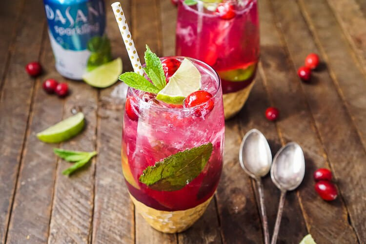 This Cranberry Mojito Punch is a festive, sparkling, and fruity large-batch cocktail!