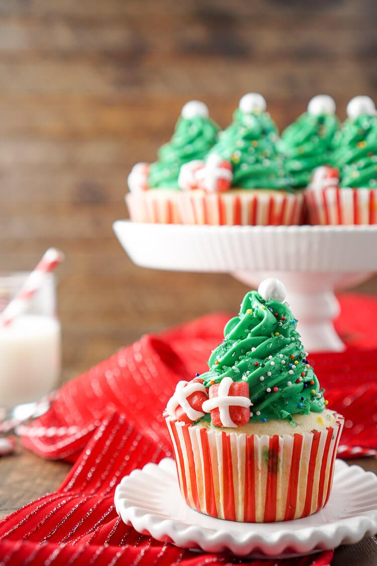 I love these Christmas Tree Cupcakes! They're so cute and great to make with the kids! Plus they're easier than they look and are such a fun and festive dessert for holiday parties!