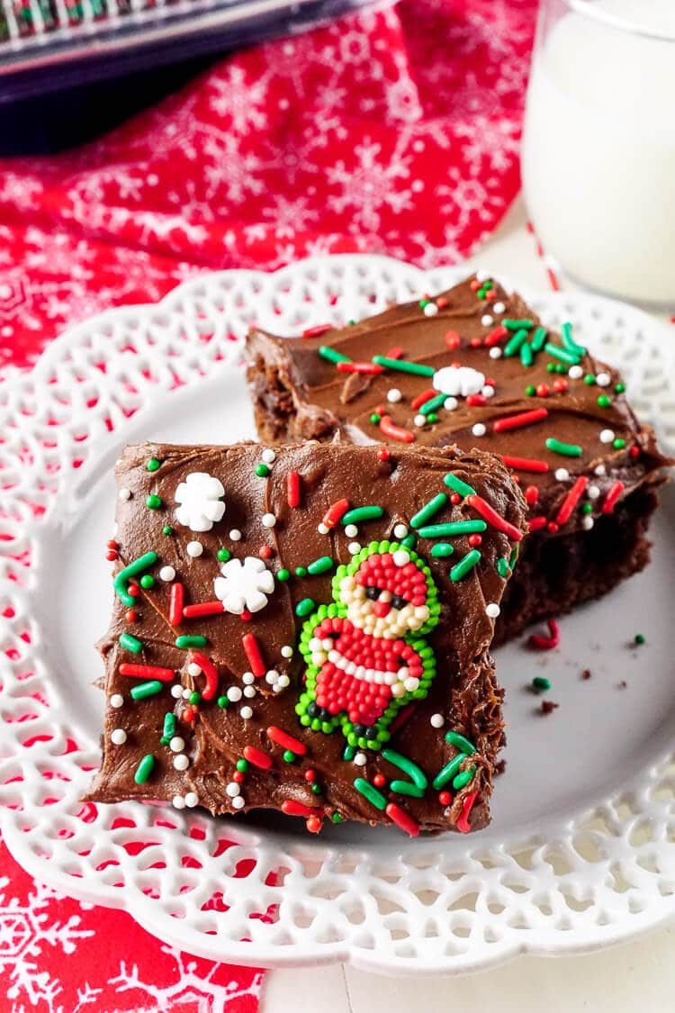 These Holiday Frosted Brownies are a classic dessert that's been given a festive touch with fun sprinkles! It's such and EASY Christmas recipe and one the kids can easily help make! Bake them up in Reynolds Disposable Bakeware for easy and fuss-free transportation to parties or to give as gifts!