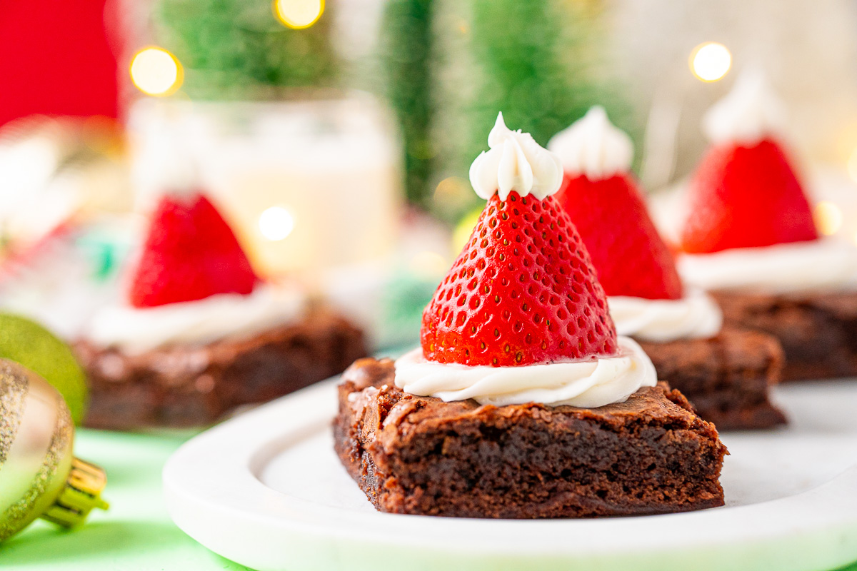 These Santa Hat Brownies are a simple and festive rich chocolate dessert the whole family will love! Perfect for parties and family get-togethers!