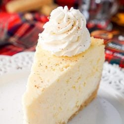This Eggnog Cheesecake Recipe is enclosed in a sweet shortbread cookie crust and laced with whisky and nutmeg for the ultimate holiday dessert!