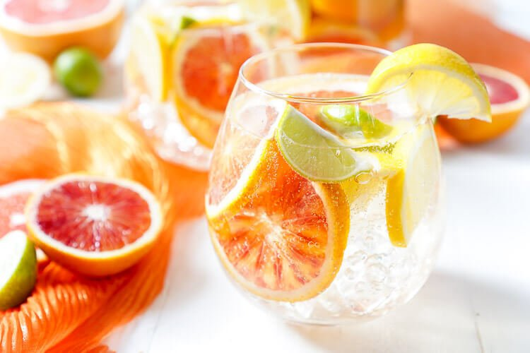 This Citrus Sangria is packed with fresh ruby red grapefruit, blood oranges, lemons, and key limes for a bright and zesty cocktail perfect for a party!v