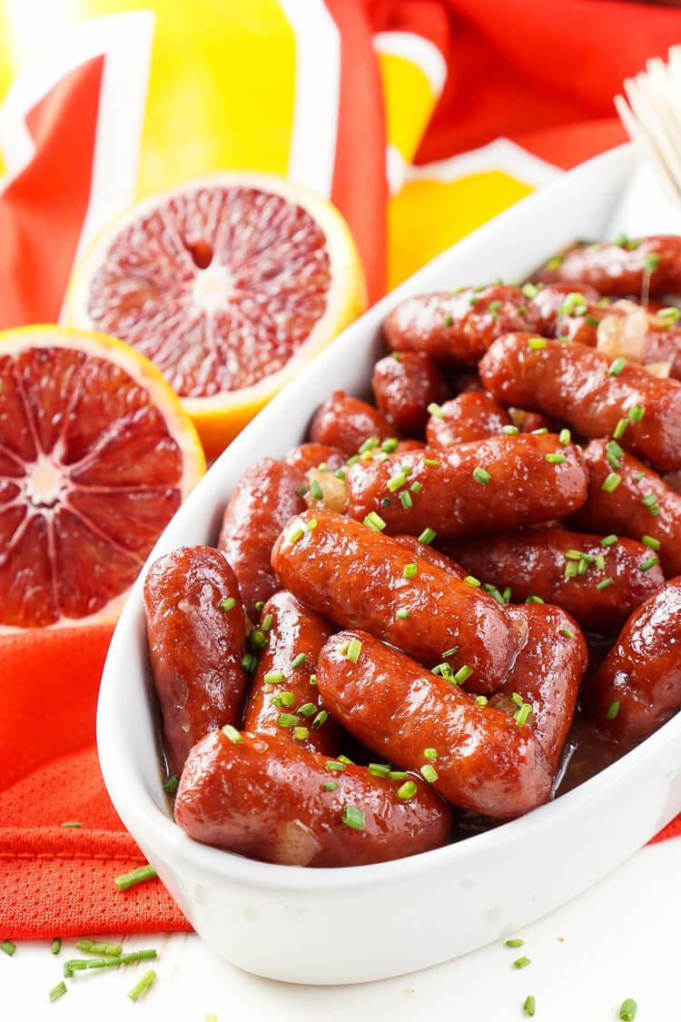 These Spicy Blood Orange Lit'l Smokies sausages are an easy appetizer with an Asian flair and a hint of heat that's perfect for game days! Made in the crock pot and ready in less than 2 hours!