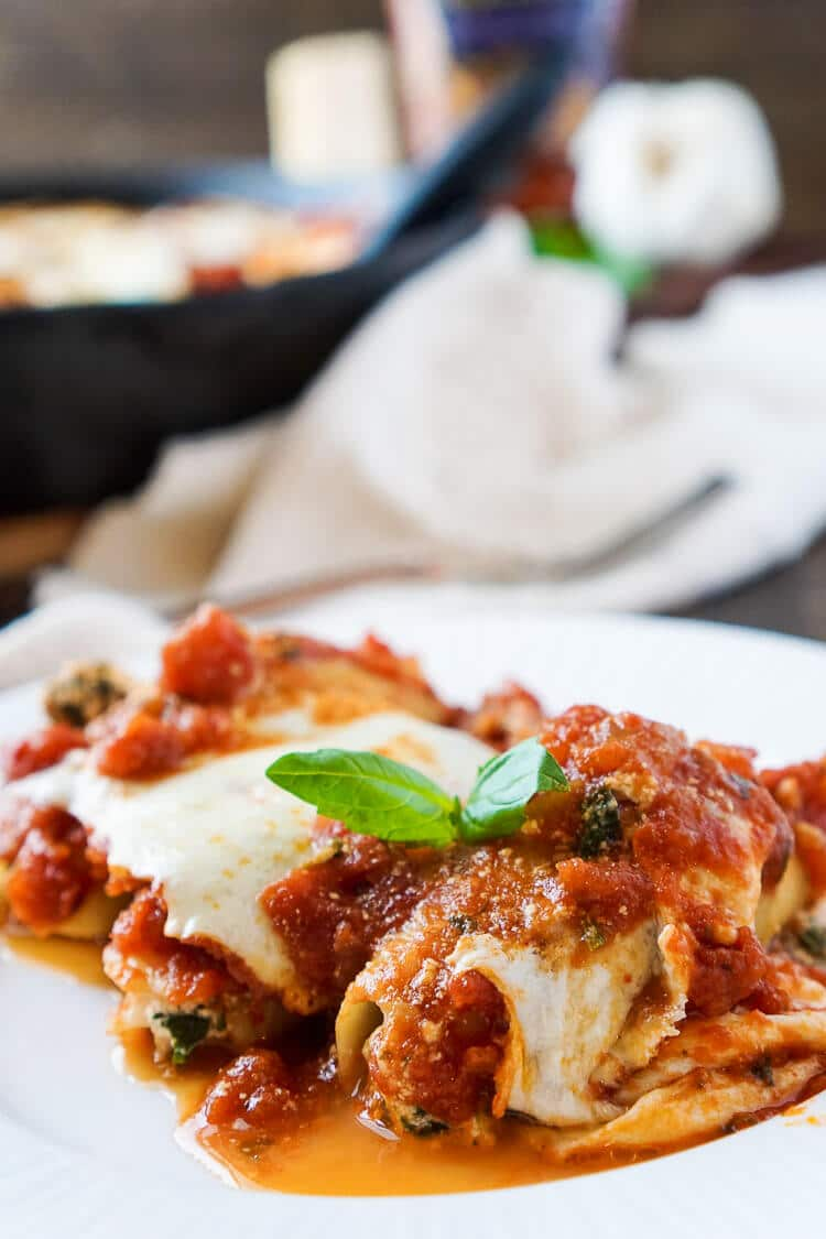 These Easy Stuffed Shells are a cozy Italian meal loaded with amazing flavors! A mix of ricotta, romano, and mozzarella cheeses bring this dish to life with a hint of spinach baked in a vibrant sauce!