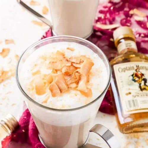 This Spiked Coconut Vanilla Steamer is one of the coziest winter cocktails you'll ever have! Made with real vanilla beans, coconut, milk, and spiced rum! It's delicious and frothy and topped with toasted coconut!