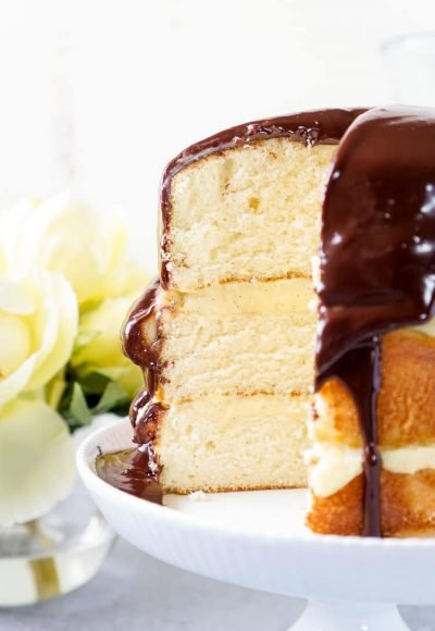 This Triple Layer Boston Cream Pie is a CLASSIC if there ever was one! A delicious rum infused cake, topped with vanilla bean pastry cream and homemade chocolate ganache! A rich and wonderful New England dessert!
