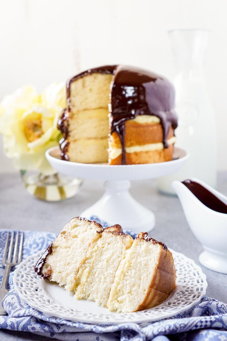 This Triple Layer Boston Cream Pie is a CLASSIC if there ever was one! A rich and wonderful New England dessert! Three layers of fluffy yellow cake with two layers of vanilla bean pastry cream topped with a rich chocolate ganache!