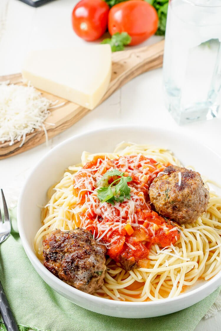 This Homemade Spaghetti and Meatballs recipe is loaded with classic Italian flavor the whole family will love!