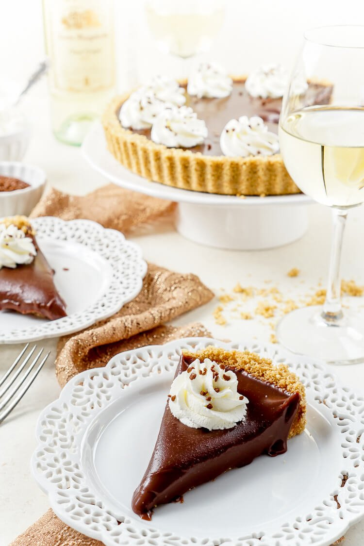 This 5-Ingredient No Bake Milk Chocolate Tart is both simple and decadent! It pairs beautifully with milk or Pinot Grigio for the perfect date night dessert!