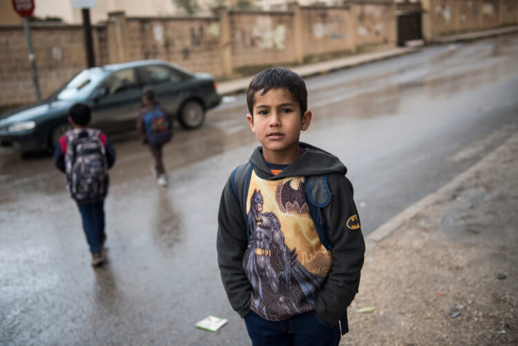 Zaher is eight years old and lives in an apartment with his family in Irbid, Jordan on February 7, 2016. His family left Syria several years ago, not long after the war broke out, but he still remembers and misses his home in Syria. Zaher goes to school in the community and enjoys playing soccer when he's able to go outside. His family has received emergency cash assistance from CARE to help them with purchasing food and other basic household items. photo/Carey Wagner for CARE