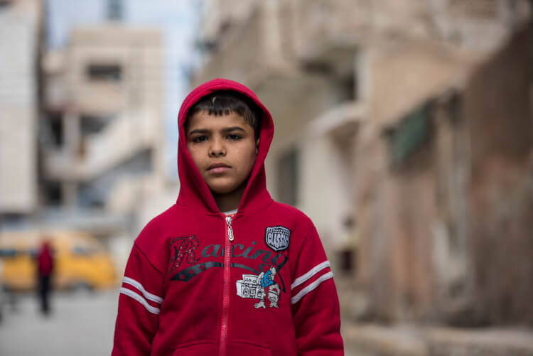 Twelve-year-old, Shadi left Syria with his family several years ago when his neighborhood came under bombardment. They were also experiencing food shortages and his father was being threatened. They now live in an apartment in Zarqa, Jordan on February 8, 2016. Shortly after arriving in Jordan, Shadi learned his home in Syria was destroyed by barrel bombs, as well as, his bicycle which he misses very much. Shadi hopes to one day return to a safe Syria, but for now, he goes to school in Zarqa and enjoys studying math and science. He enjoys drawing and playing soccer. He hopes to one day be a doctor so he can help people. CARE provides psychosocial support to Shadi through providing him a safe recreational place to draw, play games and engage with professional case workers. photo/Carey Wagner for CARE